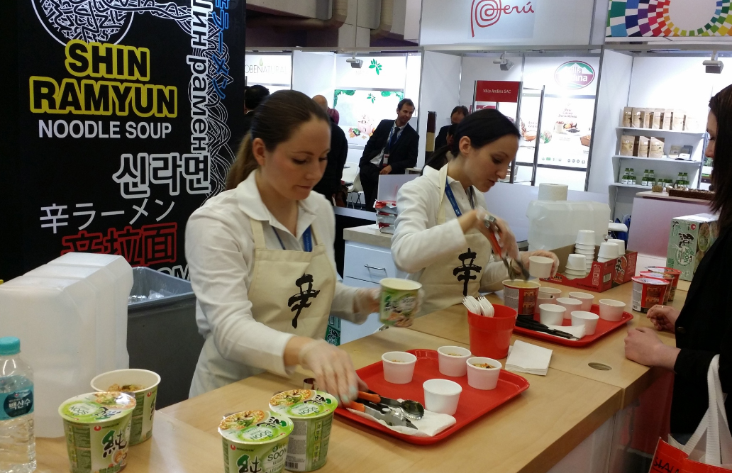 Photo of staffs serving sample food