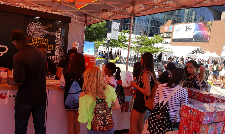 Photo of people in the Nongshim pop up event tents