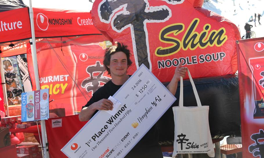 Photo of winner holding a Shin Bag & Big Check