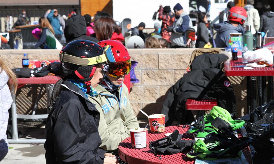 Photo of two women eating Shin Ramyun Cups